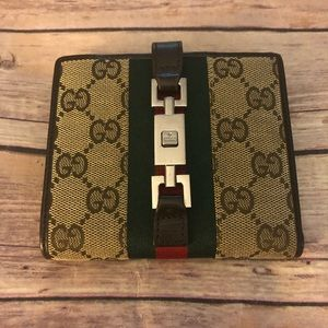 Gucci GG Jackie web canvas leather bifold wallet.